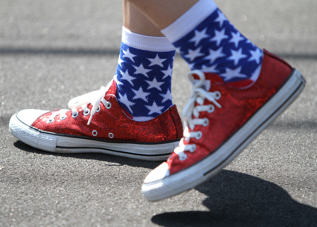 . Laura Russell of the Redwood City Twirlers wears patriotic shoes and socks as she gets ready to march in Redwood City\'s 75th annual Fourth of July Parade on Thursday, July 4, 2013. (Kirstina Sangsahachart/ Daily News)