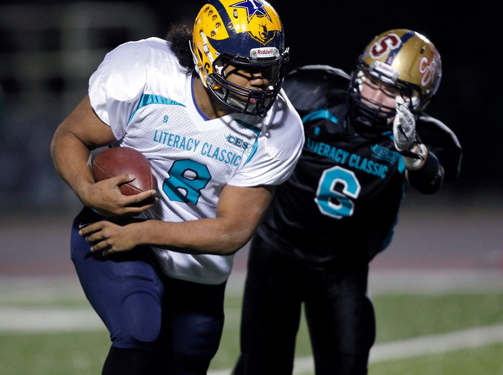 . <p>20. VITA VEA � DEFENSIVE END � MILPITAS</p> Vea (8) makes a run as he is pursued by the South\'s Kevin Kiff in the second quarter of the Literacy All-Star high school football game at San Jose City College in San Jose, Calif. on Saturday, January 26, 2013. (Jim Gensheimer/Staff)