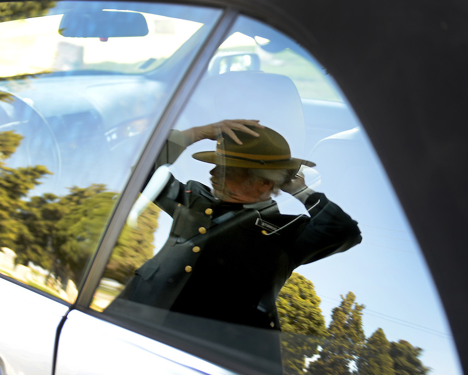 . Dressed in his Army uniform from when he served from 1968-73, Frank Dorritie, uses his car window reflection to adjust his hat before playing taps at the Union Cemetery on Thursday, May 23, 2013, in Brentwood, Calif.  (Susan Tripp Pollard/Bay Area News Group)