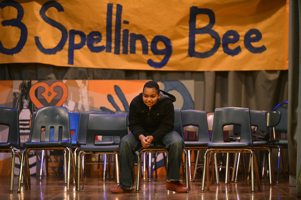 . Surrounded by the empty seats of former contestants, Sankofa Academy sixth-grader Adam Ansari keeps his focus on his way to taking first place in the school\'s second annual spelling bee in Oakland, Calif. on Wednesday, Jan. 23, 2013. (Kristopher Skinner/Staff)