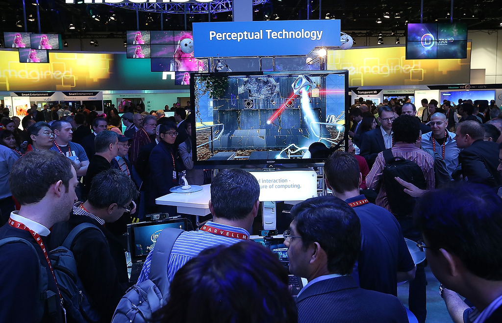 . Attendees crowd around an Intel perceptual technology display during the 2013 International CES at the Las Vegas Convention Center on January 8, 2013 in Las Vegas, Nevada. (Photo by Justin Sullivan/Getty Images)