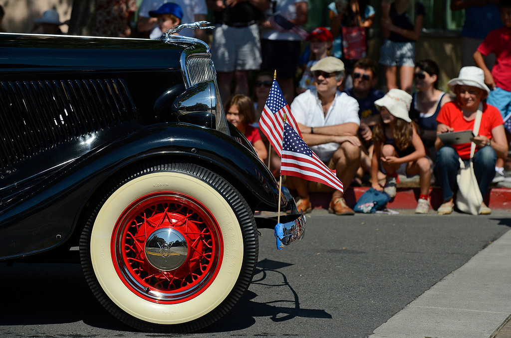 . U.S. flags decorate a car participating in the 30th anniversary Lamorinda Fourth of July parade and celebration on Thursday, July 4, 2013. (Jose Carlos Fajardo/Bay Area News Group)