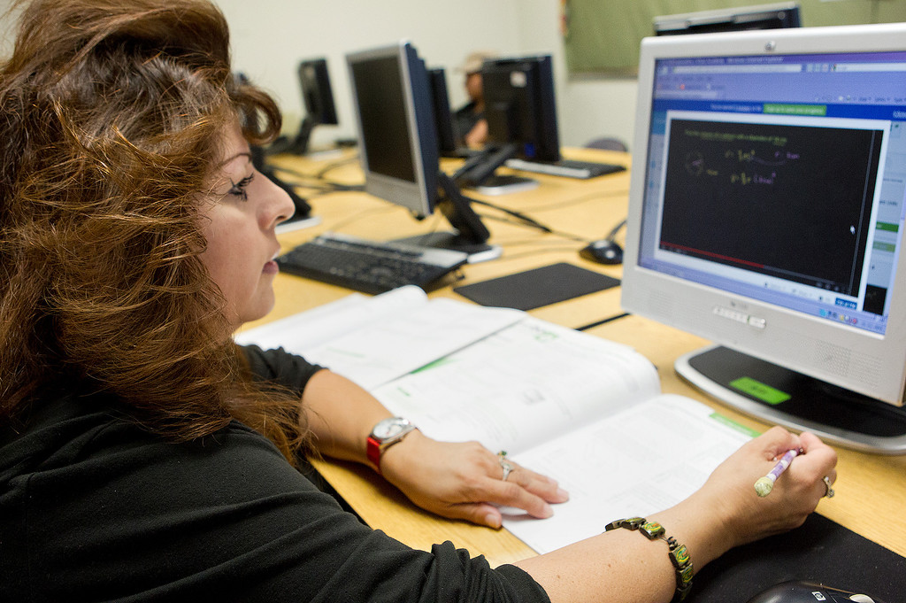 . Lydia Gonzalez, 46, uses the computer to study geometry for the GED math test at the computer lab of the Metropolitan Adult Education Program (MetroED) in San Jose, Calif. on Tuesday, July 2, 2013.  (LiPo Ching/Bay Area News Group)