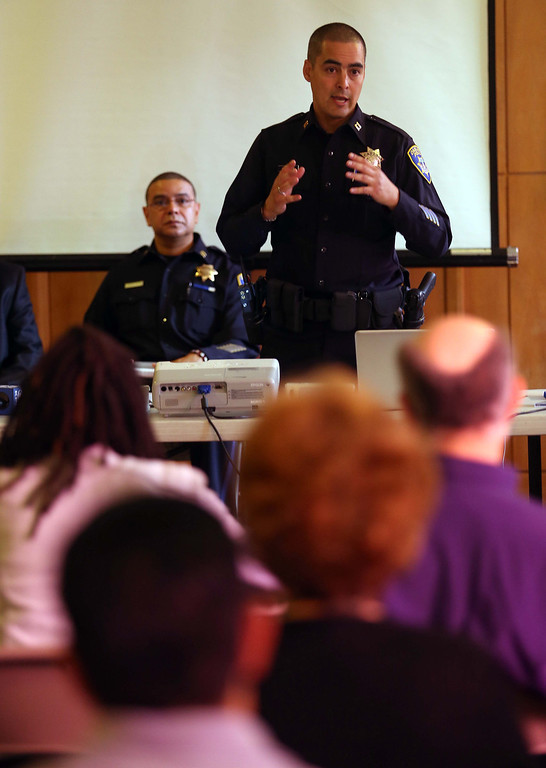 . Oakland police Capt. Anthony Toribio meets with local merchants and community members at Lake Shore Avenue Baptist Church in Oakland, Calif., on Wednesday, July 3, 2013. To the left is Capt. Rick Orozco.The meeting was held to update merchants on recent crime trends and prevention, including the double homicide at the Wing Stop restaurant on July 1. (Jane Tyska/Bay Area News Group)