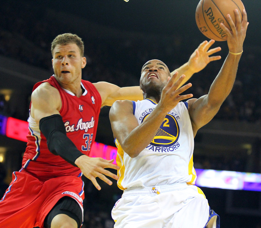. The Warriors\' Jerrett Jack (2) battles Clippers\' Blake Griffin (32) as he goes up for a shot in the second half of the basketball game at the Oracle Arena in Oakland, Calif., on Monday, Jan. 21, 2013. (Laura A. Oda/Staff)