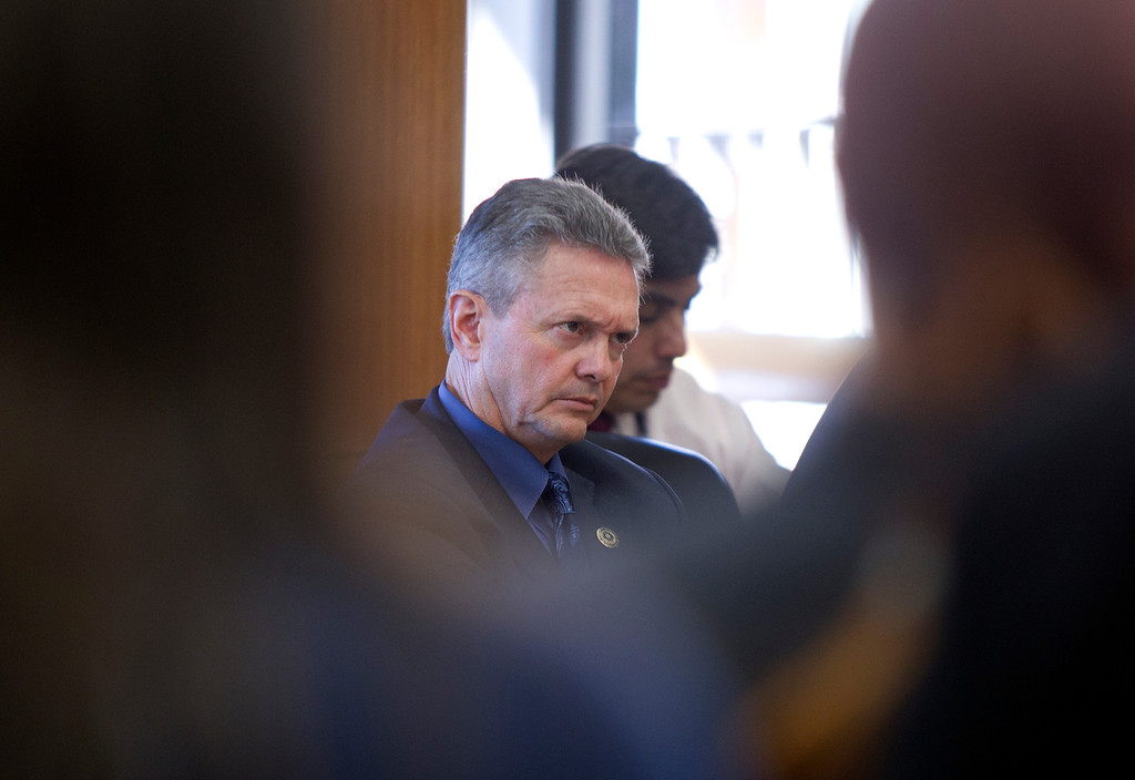 . Alameda County Sheriff Gregory J. Ahern, left, listens to public comment during a hearing on his agency\'s plan to acquire a drone for aerial enforcement, Thursday, Feb. 14, 2013 at the Alameda County Administration Building in Oakland, Calif. (D. Ross Cameron/Staff)