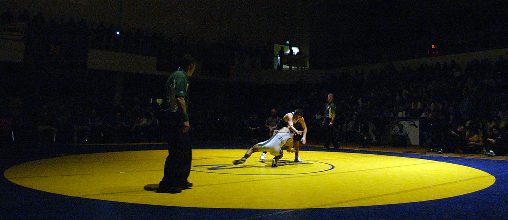 . De La Salle\'s Nathan Cervantes, left, faces off against Freedom\'s Ricky Coster in the 120-pound finals at the North Coast Section wrestling championships held at Newark Memorial High School in Newark, Calif., on Saturday, Feb. 23, 2013. Coster would get the win. (Anda Chu/Staff)