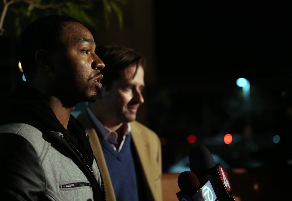 . Omari Sealey, uncle of 13-year-old Jahi McMath, says that his niece will be moved to an undisclosed location in the Bay Area as family attorney Chris Dolan stands next to him during a news conference outside Children\'s Hospital Oakland in Oakland, Calif., on Thursday, Dec. 26, 2013.  (Ray Chavez/Bay Area News Group)