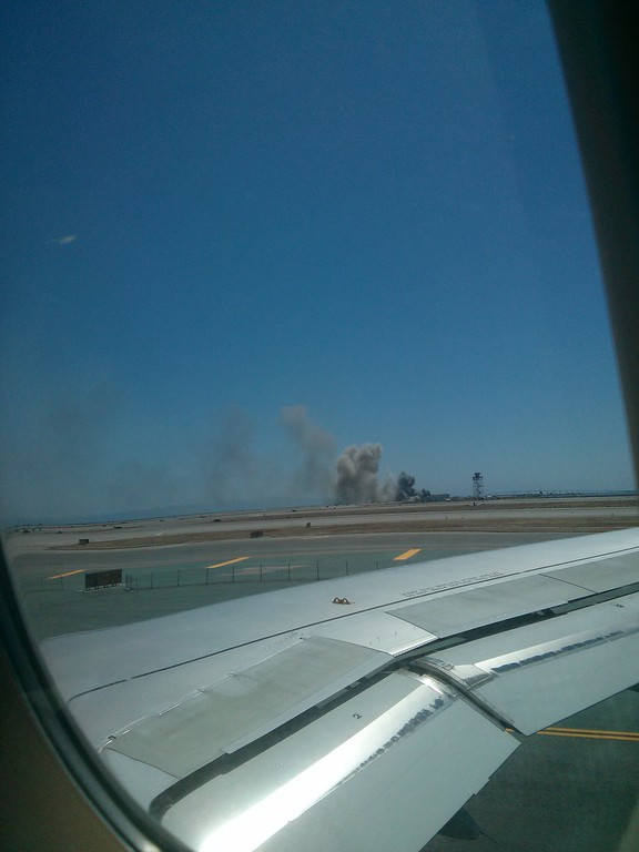 . A photo taken by John Khoo, of Berkeley, of the Boeing 777 plane that crash landed at San Francisco International Airport in San Francisco, Calif., on Saturday, July 7, 2013. Khoo took the photo from is seat while waiting to takeoff to Europe. (John Khoo)