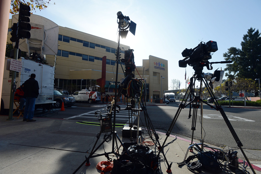 . Television news crew equipment lines the sidewalk near Children\'s Hospital Oakland after spokesperson Sam Singer addressed the media regarding Jahi McMath in Oakland, Calif., on Monday, Dec. 30, 2013. (Kristopher Skinner/Bay Area News Group)