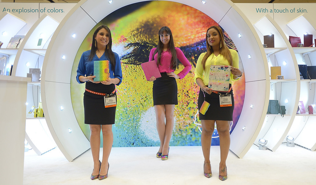 . Hostesses of Appeal Brazil offer iPad cases at the 2013 International CES at the Las Vegas Convention Center on January 8, 2013 in Las Vegas, Nevada. (JOE KLAMAR/AFP/Getty Images)