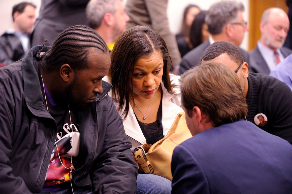 . Martin Winkfield, left, Jahi\'s stepfather, Jahi\'s grandmother Sandra Chatman and uncle Omari Sealey consult with attorney Christopher Dolan at a hearing for Jahi McMath in Oakland, Calif., on Tuesday, Dec. 24, 2013. Judge Evelio Grillo on Tuesday denied a petition by the family of Jahi McMath to have Children\'s Hospital Oakland keep the brain dead girl on a ventilator past Dec. 30. (Susan Tripp Pollard/Bay Area News Group)