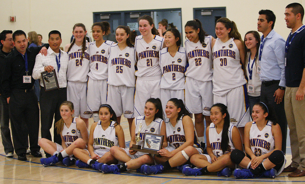 . Presentation poses for a team photo after the game during the CCS Division II girls basketball finals at Santa Clara High School in Santa Clara, Calif. on Friday, March 1, 2013. The Presentation Panthers beat the Woodside Wildcats, 49-34. (Jim Gensheimer/Staff)