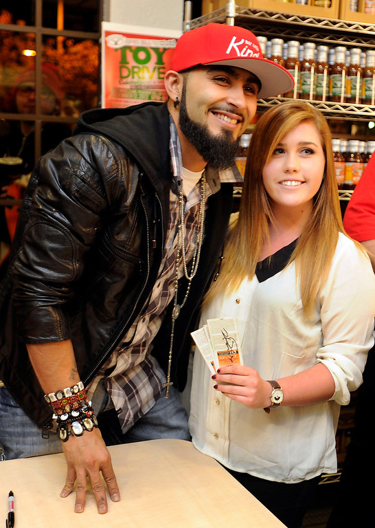 . Giants reliever Sergio Romo poses for a photo with Karina Rodegeb at Kinder\'s Meats and Deli on Wednesday, Dec. 12,  2012 in Pleasant Hill, Calif. (Susan Tripp Pollard/Staff)