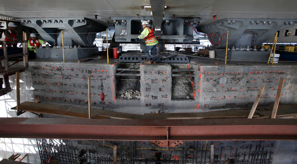 . Caltrans shows off the work being done to repair the broken bolts on pier E2 of the new eastern span of the Bay Bridge, Friday, Aug. 23, 2013. Shims have been added to the two bearing assemblies on either side of the shear key that is being fitted for a permanent saddle. (Karl Mondon/Bay Area News Group)