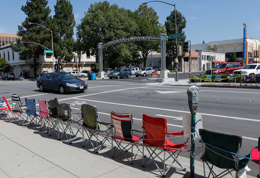 . Chairs line Marshall Street in Redwood City, Calif., on Wednesday, July, 3, 2013.  Hundreds of people, some as early as Tuesday, saved a spot to see the popular 4th of July parade in Redwood City on Thursday. (John Green/Bay Area News Group)