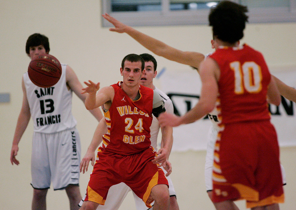 . Willow Glen\'s Taylor Meeker passes the ball out to Tucker Bacon in the fourth quarter during the CCS Division II boys basketball finals at Santa Clara High School in Santa Clara, Calif. on Friday, March 1, 2013. The Saint Francis Lancers beat the Willow Glen Rams, 56-46. (Jim Gensheimer/Staff)