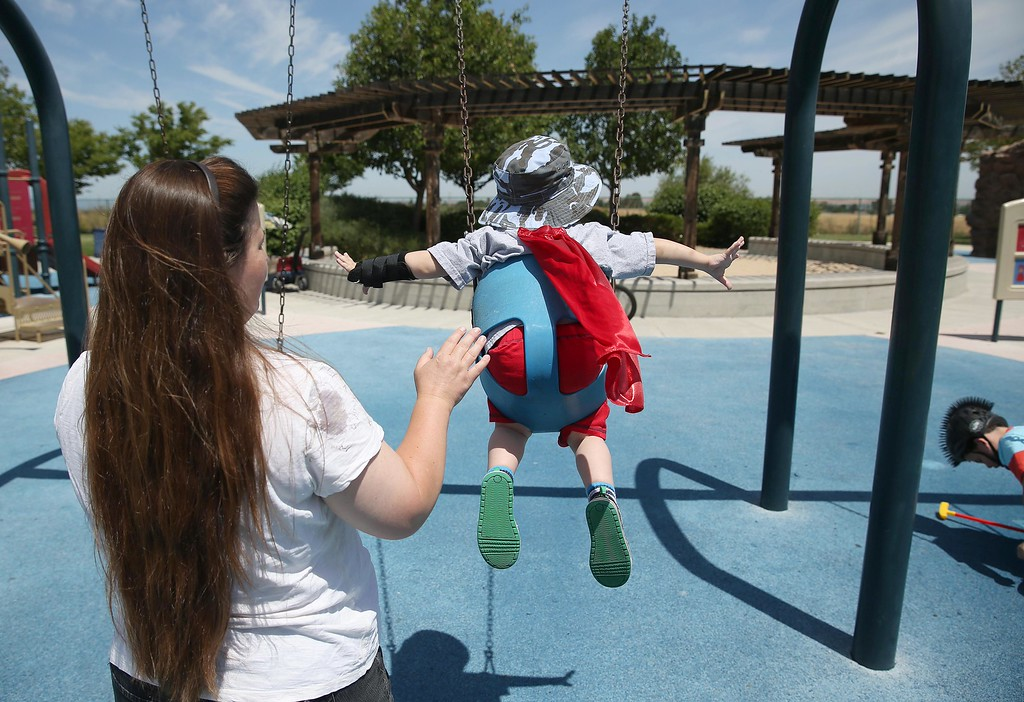. Matthew Ouimet, 3, gets a push from his mom at Markley Creek Park in Antioch, Calif., on Friday, May 23, 2014. (Jane Tyska/Bay Area News Group)