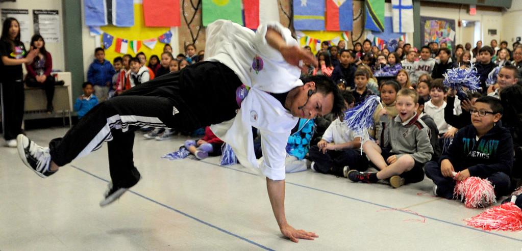 ". R J Navalta, of Fremont, performs a break dancing move at El Monte Elementary School as part of a \""Science Rocks\"" program in Concord, Calif., on Tuesday, Feb. 26, 2013.  (Susan Tripp Pollard/Staff)"