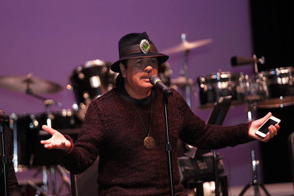 . Carlos Santana speaks to music students at San Leandro High School in San Leandro, Calif., on Wednesday, Jan. 9, 2013. (Anda Chu/Staff)