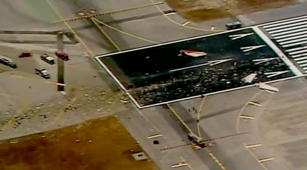 . This image courtesy fo CBS affiliate KPIX, shows debris from an Asiana Airlines Boeing 777 after it crash landed on the runway at San Francisco International Airport on July 6, 2013. Video footage showed the jet, Flight 214 from Seoul, on its belly surrounded by firefighters. (KPIX via AFP/Getty Images)