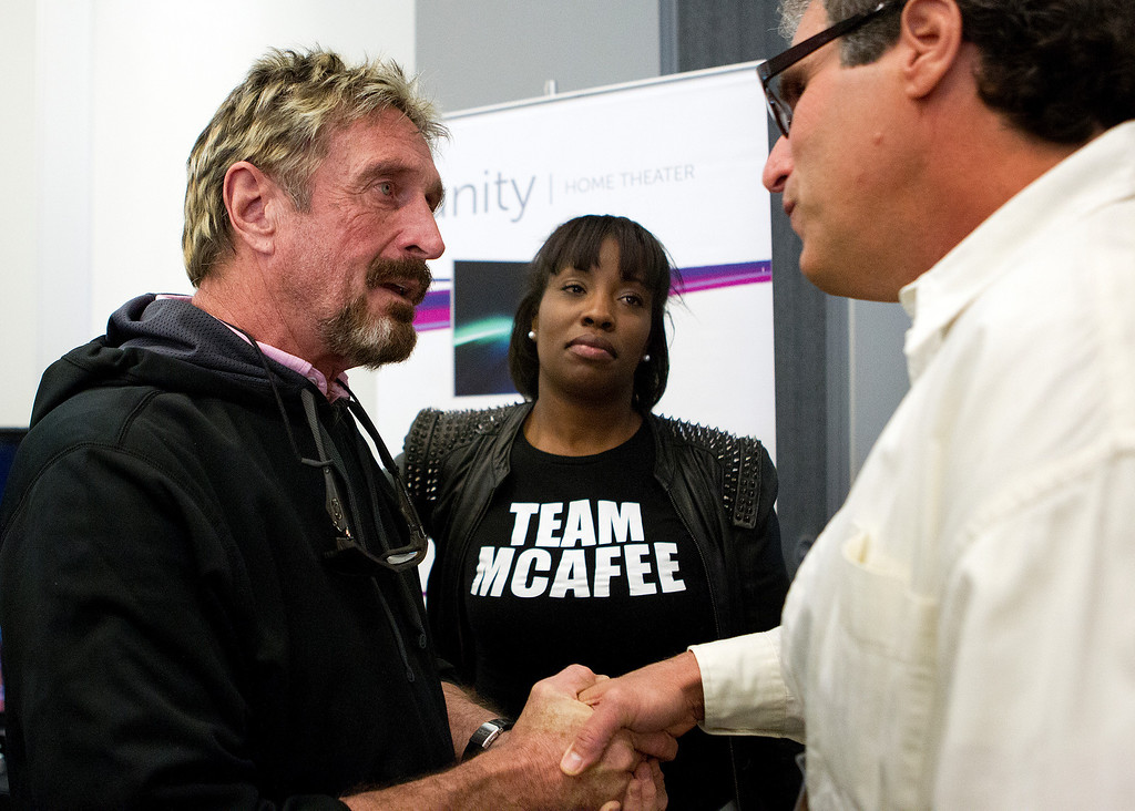 . John McAfee, from left, and his wife Janice Dyson, speak with Jai Hudes at the C2SV Technology Conference + Music Festival, at the McEnery Convention Center in San Jose, Calif., on Saturday, Sept. 28, 2013.   (LiPo Ching/Bay Area News Group)