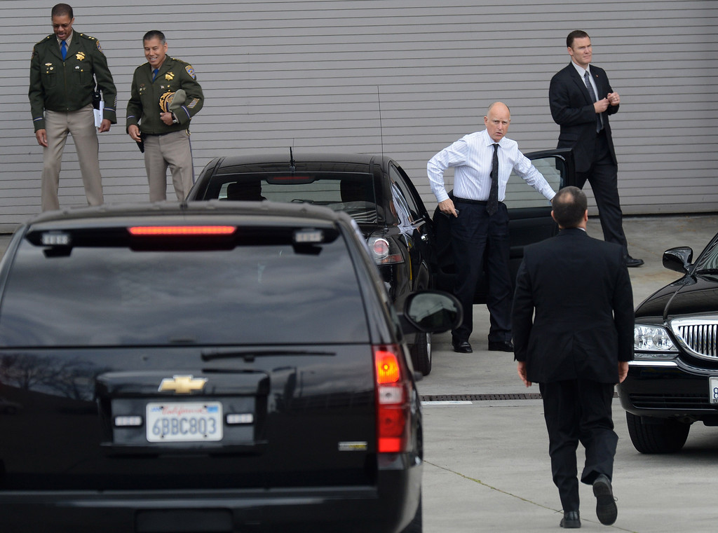 ". Gov. Jerry Brown arrives in the loading dock area at the HP Pavilion in San Jose, Calif., on Thursday, March 7, 2013. Thousands are attending a memorial for Santa Cruz police officers Loran ""Butch\"" Baker and Elizabeth Butler, who lost their their lives in the line of duty on Feb. 26. (Dan Honda/Bay Area News Group)"