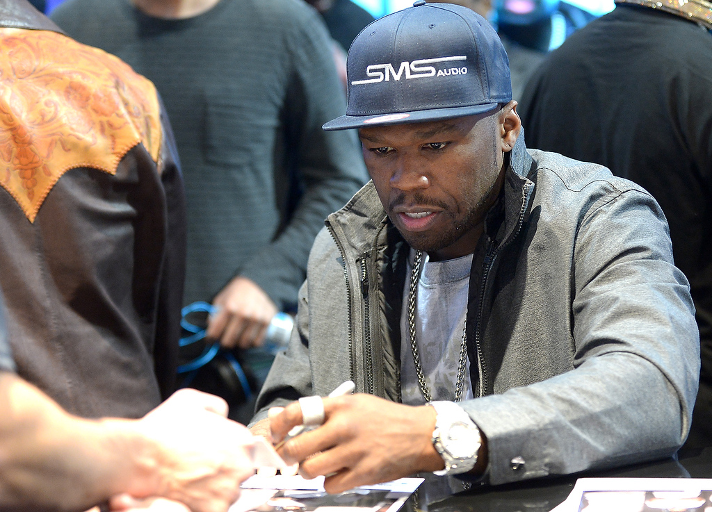 . 50 Cent signs autographs at SMS Audio booth at the Las Vegas Convention Center on January 9, 2013 in Las Vegas, Nevada. (JOE KLAMAR/AFP/Getty Images)
