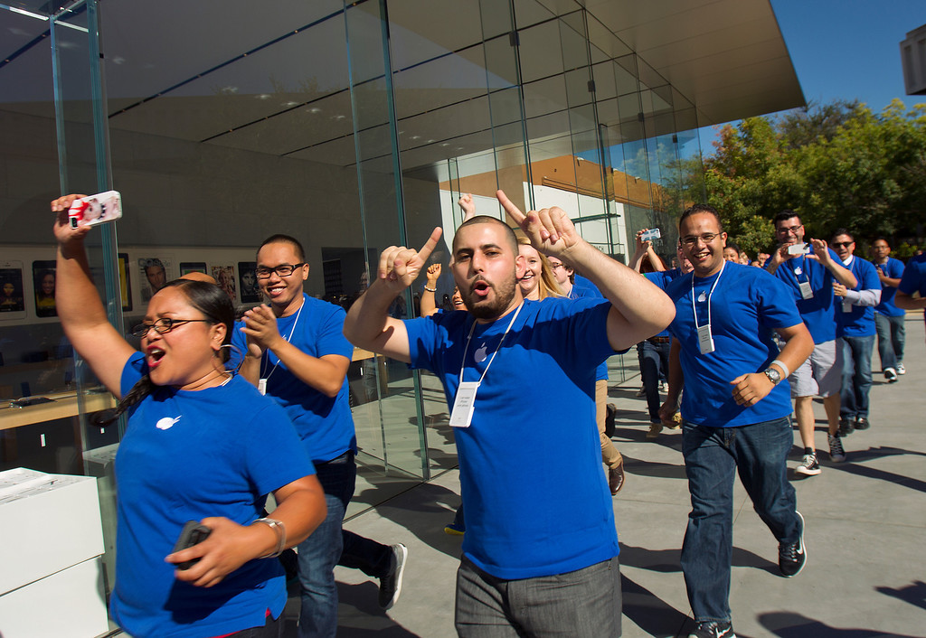 . Apple store staff parade before the opening of the redesigned Apple Store, at the Stanford Shopping Center  in Palo Alto, Calif., on Saturday, Sept. 7, 2013.  (LiPo Ching/Bay Area News Group)