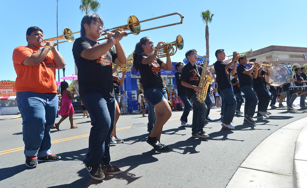 . The Pittsburg High School marching band play at the 29th annual Pittsburg Seafood and Music Festival in the city\'s historic Old Town in Pittsburg, Calif., on Saturday, Sept. 7, 2013. (Dan Rosenstrauch/Bay Area News Group)