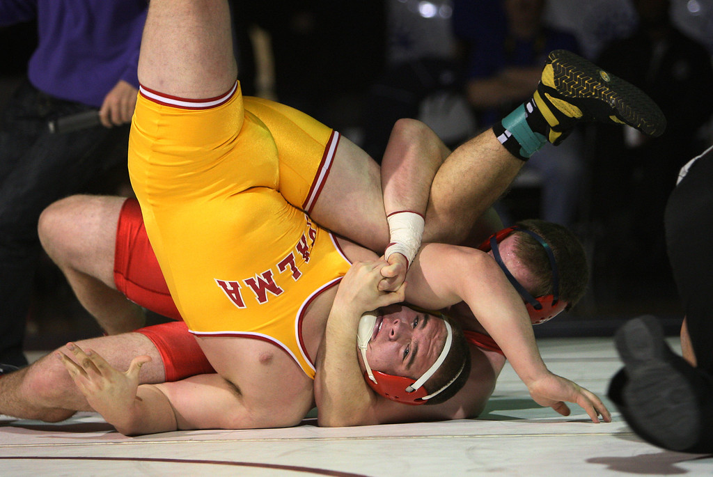 . Saratoga\'s Graham Grant tries to pin Palma\'s Tyler Escoto in his victory match in the 220 pound class during the CCS wrestling championships at Independence High School in San Jose, Calif. on Saturday, Feb. 23, 2013. (Jim Gensheimer/Staff)