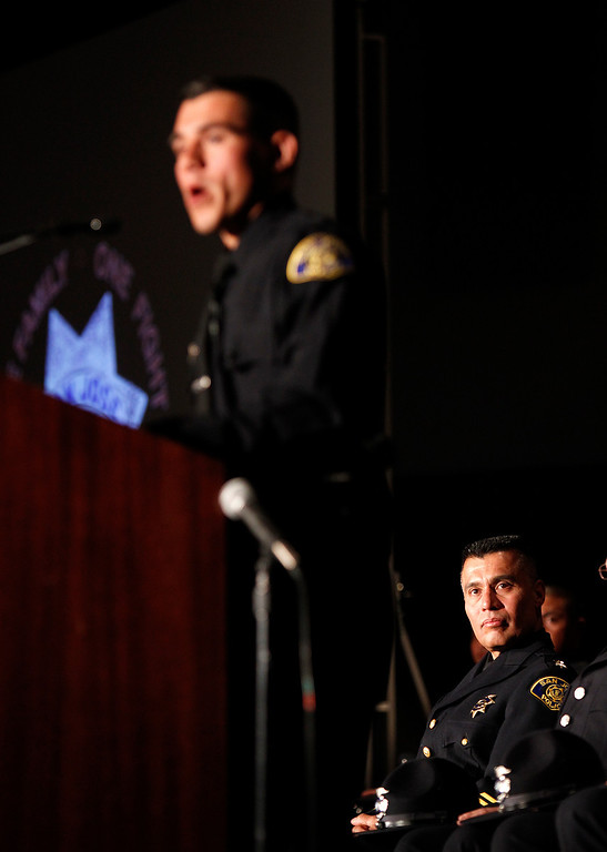 . At left, Chief of Police Larry Esquivel listens to San Jose Police Academy Class President David Cortez during the San Jose Police Academy graduation in San Jose, Calif. on Friday, March 15, 2013.   (LiPo Ching/Staff)