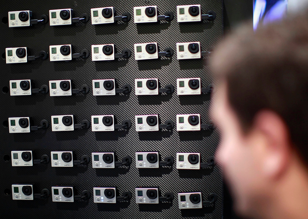 . A man demonstrates the capability run 30 GoPro cameras simultaneously at the GoPro booth on the first day of the Consumer Electronics Show (CES) in Las Vegas January 8, 2013. (REUTERS/Rick Wilking)