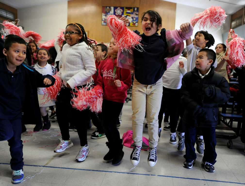 """. Students jump up for the red team using their human motion energy as Leilani Dyer, left, and Sadaf Abdiani leave the ground with their efforts at El Monte Elementary School as part of a \""""Science Rocks\"""" program in Concord, Calif., on Tuesday, Feb. 26, 2013. Radio Disney and the California State PTA brought the entertaining science program to El Monte.  (Susan Tripp Pollard/Staff)"""