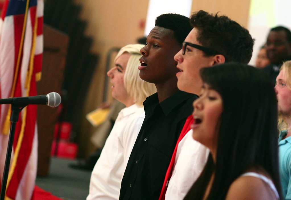 . The De Anza High School concert choir performs during a dedication ceremony for the school\'s new campus in Richmond, Calif., on Saturday, Sept. 7, 2013. This is the latest school reconstruction project in the West Contra Costa school district. (Anda Chu/Bay Area News Group)