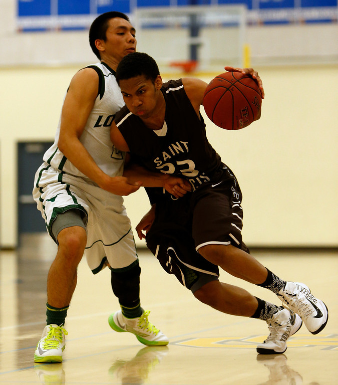 . St. Francis High School\'s Khalil Johnson (23) dribbles against Leigh High School\'s Kimo Francisco (2) in the second period for the CCS Division II Boys Basketball semifinals at Santa Clara High School in Santa Clara, Calif., on Tuesday, Feb. 26, 2013.  (Nhat V. Meyer/Staff)