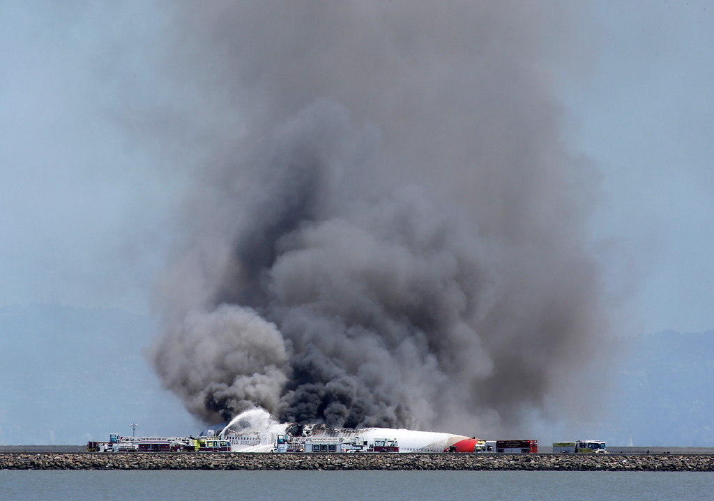 . Fire crews put out the fire of an Asiana Airlines Boeing 777 that crashed while landing at San Francisco International Airport on Saturday, July 6, 2013. (John Green/Bay Area News Group)