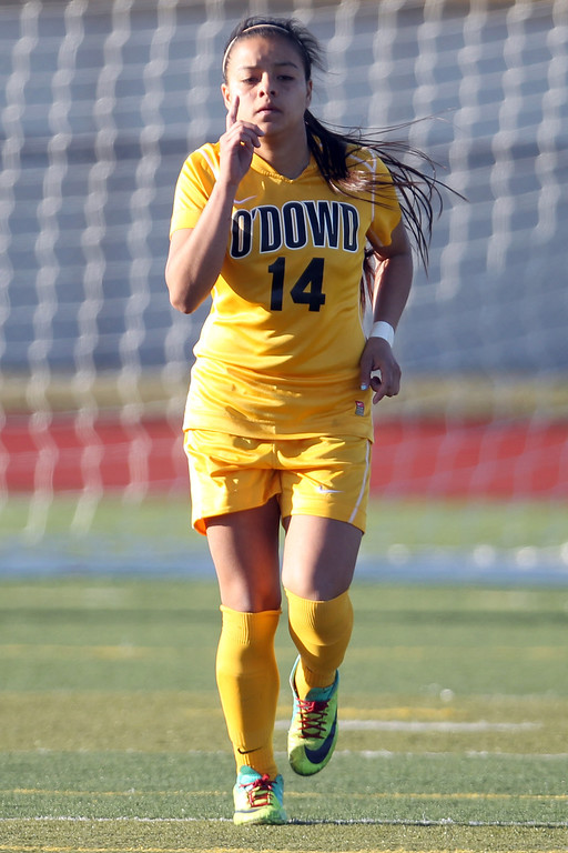 . Bishop O\'Dowd\'s Stephanie Zuniga (14) celebrates her goal during a penalty kick series against Piedmont in the North Coast Section Division II Girls Soccer Championship at Dublin High School soccer field in Dublin, Calif., on Saturday, Feb. 23, 2013. Bishop O\'Dowd won 3-2. (Ray Chavez/Staff)