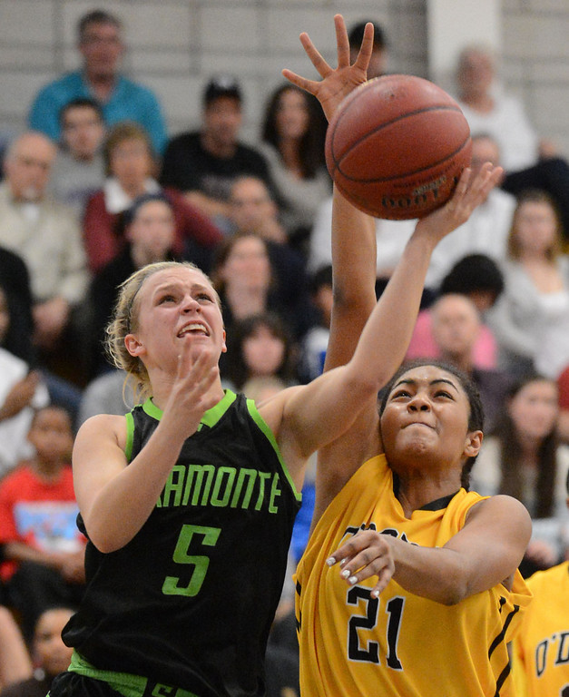 . Miramonte High\'s Allison Miller (5) left, goes up for a basket as Bishop O\'Dowd High\'s Daniella Williams (21) blocks in the second period of their Division III North Coast Section basketball game in Dublin, Calif., on Saturday, March 2, 2013. Bishop O\'Dowd High went on to win the game 77-48. (Doug Duran/Staff)