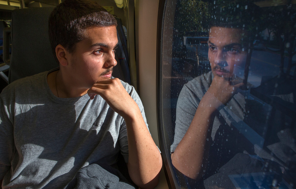 . Kieran Rege, 15, rides the train home in Menlo Park, Calif., on Wednesday, Jan. 20, 2013.  Diagnosed with autism when he was 3, Kieran is one of a growing number of children that have lost their diagnosis.Through behavioral, speech and dietary interventions, the Palo Alto teenager is now bright, sociable and confident. (John Green/Staff)
