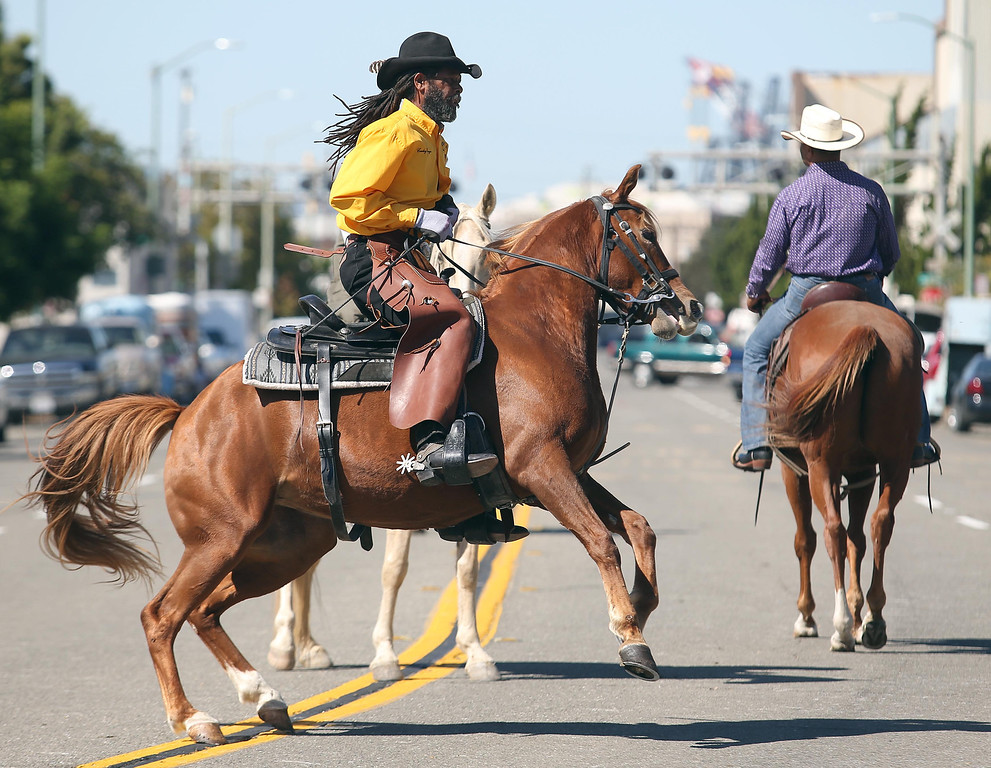 . Oakland Black Cowboy Association member Joseph Dougger rides during the 39th annual Oakland Black Cowboy Parade and Heritage Festival in Oakland, Calif., on Saturday, Oct. 5, 2013. The event also featured food, entertainment and pony rides for kids at De Fremery Park. The OBCA began in 1975 and educates the public about the role that black cowboys played in history and building of the west. (Jane Tyska//Bay Area News Group)