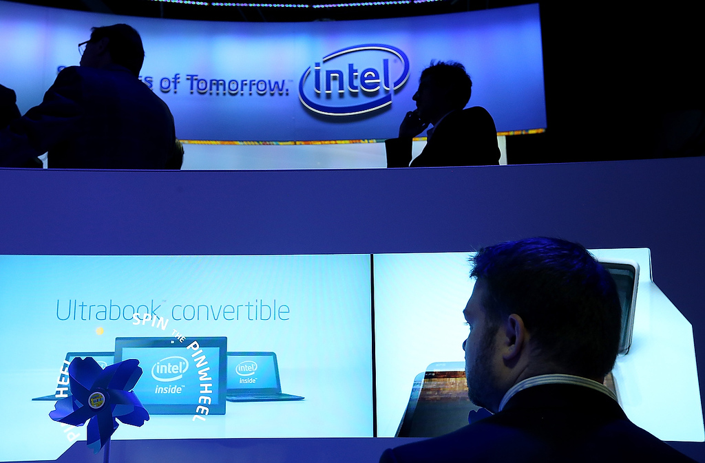 . Attendees inspect Intel UltraBooks during the 2013 International CES at the Las Vegas Convention Center on January 8, 2013 in Las Vegas, Nevada. (Photo by Justin Sullivan/Getty Images)