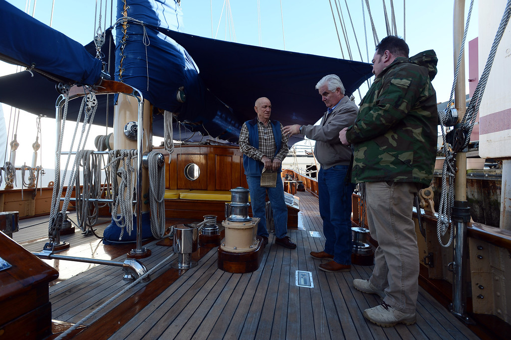 . Ship owner and captain Bill Bodle, left, chats with Jason Deitch, right, and Mike Conklin, with Sentinels of Freedom aboard the Eros, a restored 1939 English schooner, in Richmond, Calif. on Thursday, Jan. 10, 2013. (Kristopher Skinner/Staff)