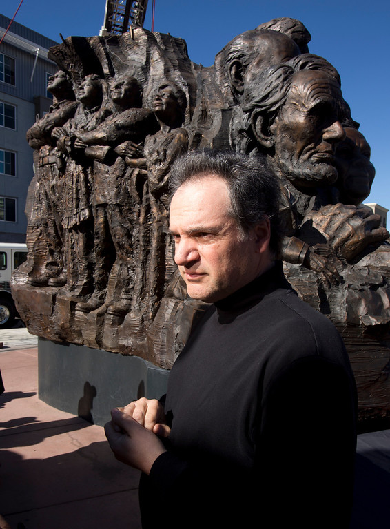 ". Mario Chiodo, the artist behind ""Remember Them,\"" stands by his paean to heroes of civil rights and humanity before the start of a ceremony to dedicate the section for 9/11 first responders and firefighters in general, Thursday, Feb. 21, 2013 in Oakland Calif. (D. Ross Cameron/Staff)"