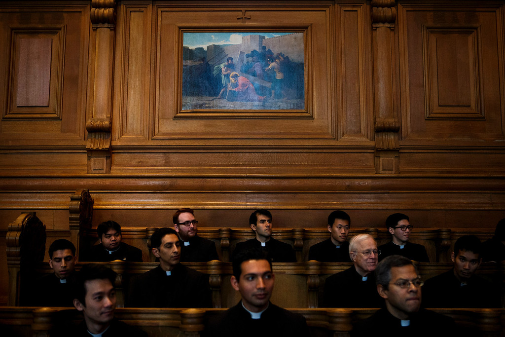 . Seminarians and faculty members wait for Cardinal William Levada\'s press conference in which Levada answered questions about the upcoming Conclave of Cardinals to elect a new Pope after the unexpected retirement of Pope Benedict XVI, on Feb. 25, 2013 at St. Patrick\'s Seminary & University in Menlo Park. (Dai Sugano/Staff)