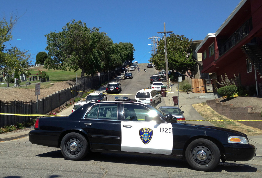 . Oakland police investigate a shooting on 2400 block of Fern Street in Oakland, Calif., on Wednesday, July 24, 2013. Officers found Judy Salamon, 66, who had been shot by an unknown suspect while she was in her vehicle, causing it to strike a parked car. (Anda Chu/Bay Area News Group)