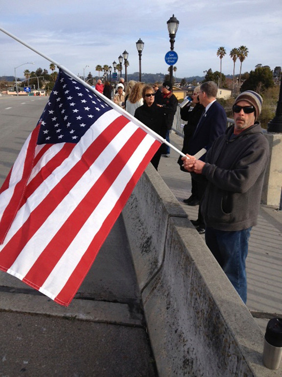 . Hank Springer waits for the procession from his vantage point on the Riverside Bridge in Santa Cruz, Calif., on Thursday, March 7, 2013. (Dan Coyro/Santa Cruz Sentinel)
