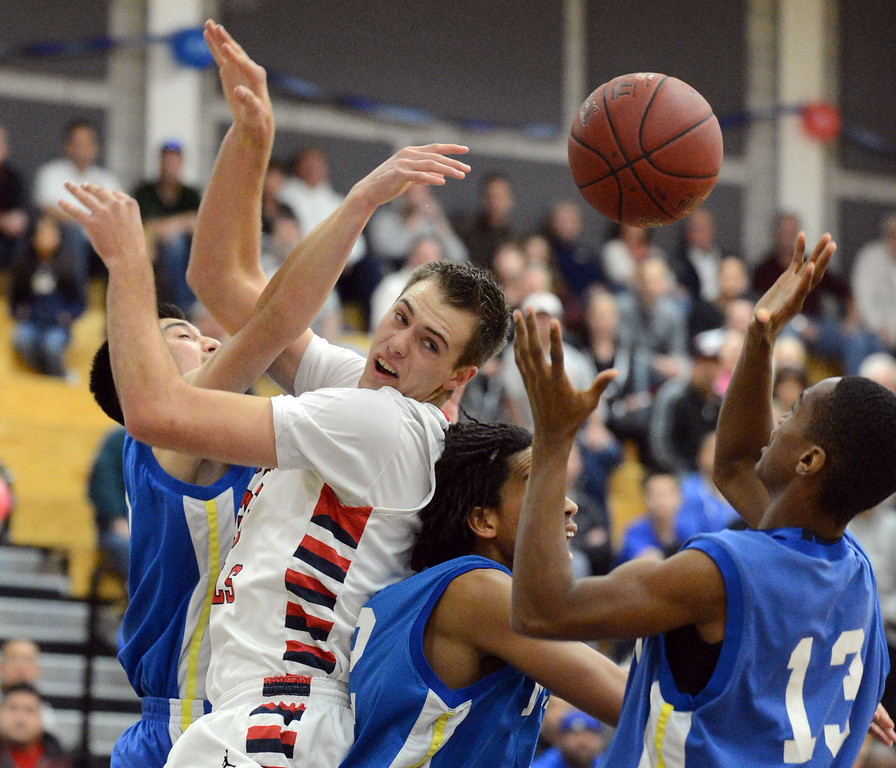 . Dublin High\'s Eric Nielsen (33) center left, and from left, Mt. Eden High\'s Noel Briones (10), Jalen Dominic (32) and Stevinair Young (13) all try to catch a rebound in the first period of their NCS Division II boys basketball semifinal game in Dublin, Calif., on Wednesday, Feb. 27, 2013. Dublin High went on to win the game 85-53. (Doug Duran/Staff)