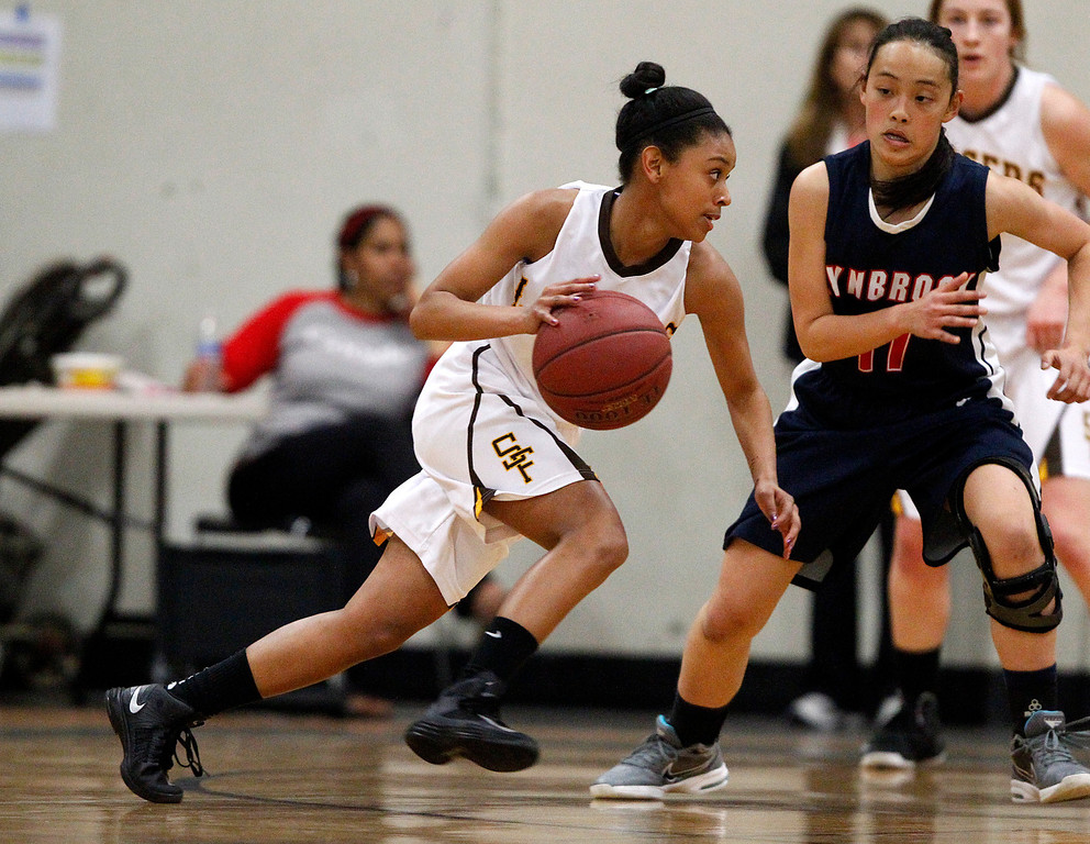 . St. Francis High School\'s Daisha Abdelkader (5) dribbles against Lynbrook High School\'s Annie Cheng (11) in the first period for the CCS Open Division Girls Basketball semifinals at Oak Grove High School in San Jose, Calif., on Wednesday, Feb. 27, 2013.  (Nhat V. Meyer/Staff)