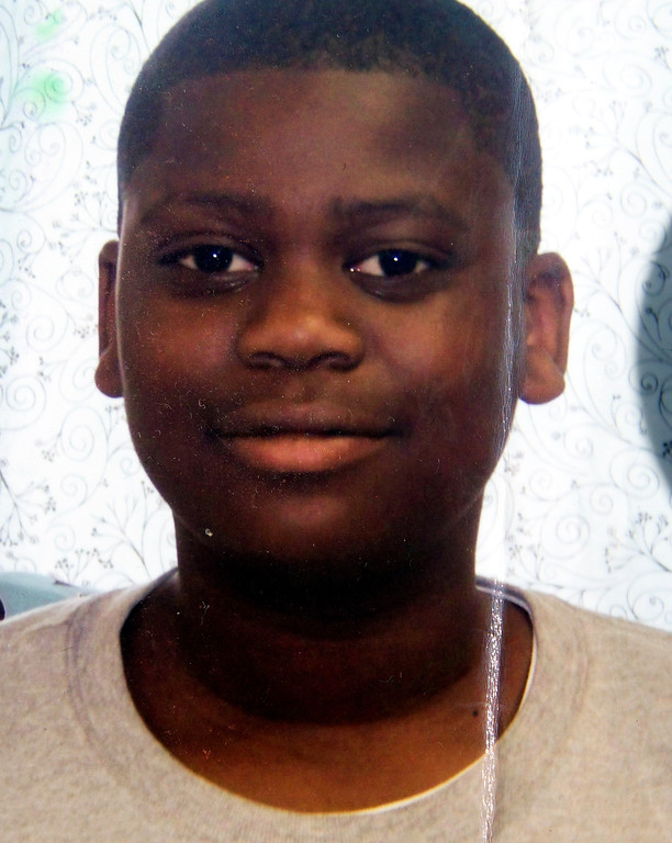 . An undated photo of Lee Weathersby III, the 13-year-old boy who was shot dead while coming home from the Boys and Girls Club on New Year\'s Eve, is copied on Thursday, Jan. 2, 2014, in Oakland, Calif. (Courtesy of the New Family)